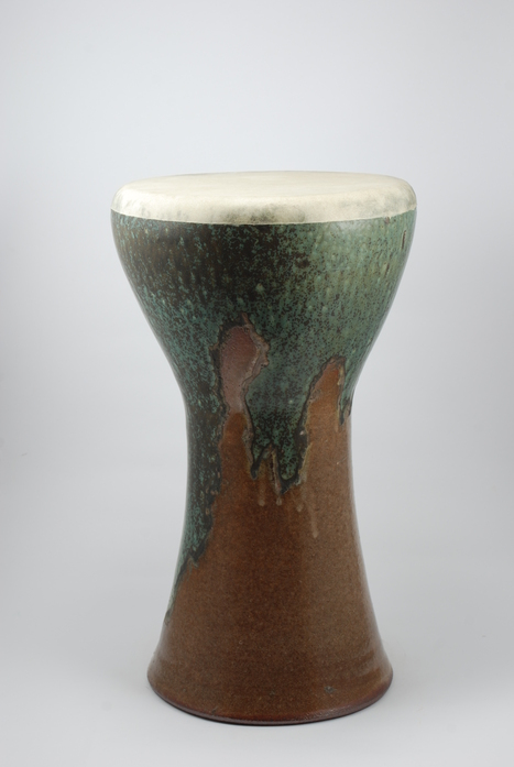 Professional quality hand made ceramic drum made by Rowshan Dowlatabadi.   (Head: 19 cm, Height:31 cm, Skin: Goat)    <hr>Price: $150