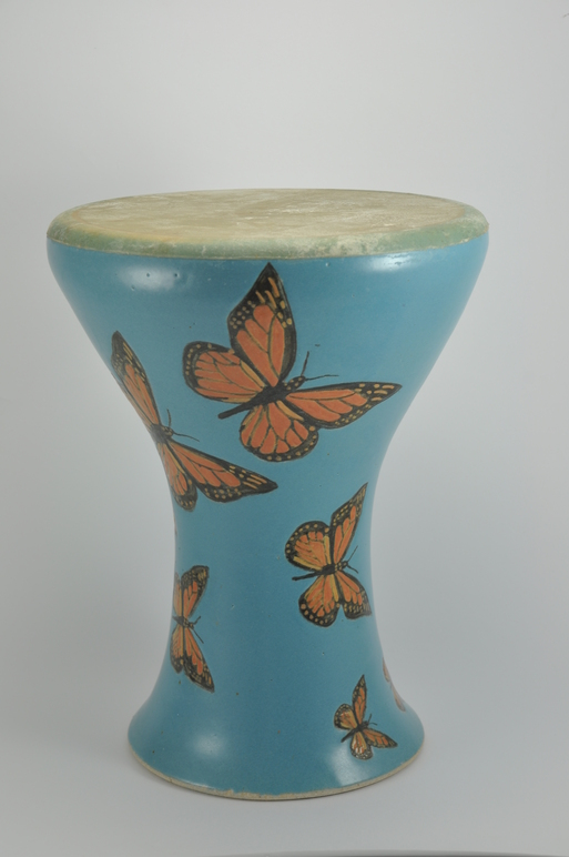 Professional quality hand made ceramic drum with design of butterflies made by Rowshan Dowlatabadi.   (Head: 22 cm, Height:32 cm, Skin: Goat)  <hr>Price: $250