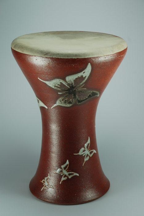 Professional quality hand made ceramic drum with design of butterflies made by Rowshan Dowlatabadi.   (Head: 21 cm, Height:33 cm, Skin: Goat)  <hr>Price: $250