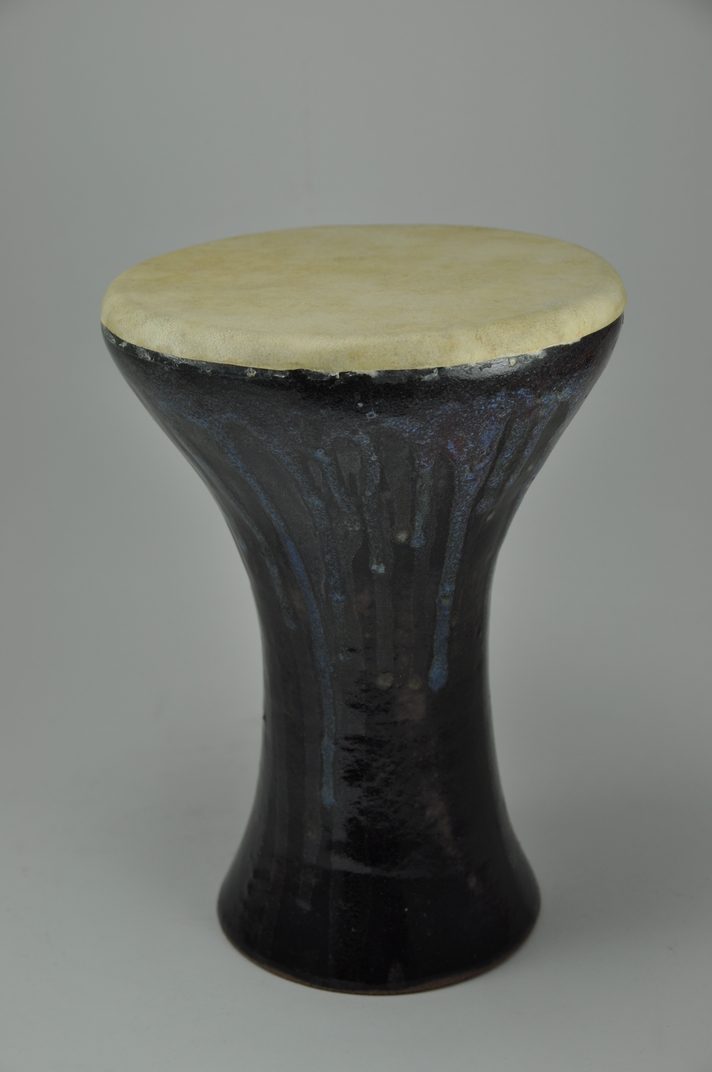 Drum_24  Professional quality hand made ceramic drum made by Rowshan Dowlatabadi.   (Head: 16.5 cm, Height:26 cm, Skin: Goat)  <hr>Price: Sold